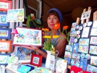 Malerin im Ladenfenster