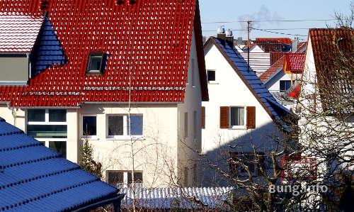 Wetter im Dezember - Schnee auf roten Dächern